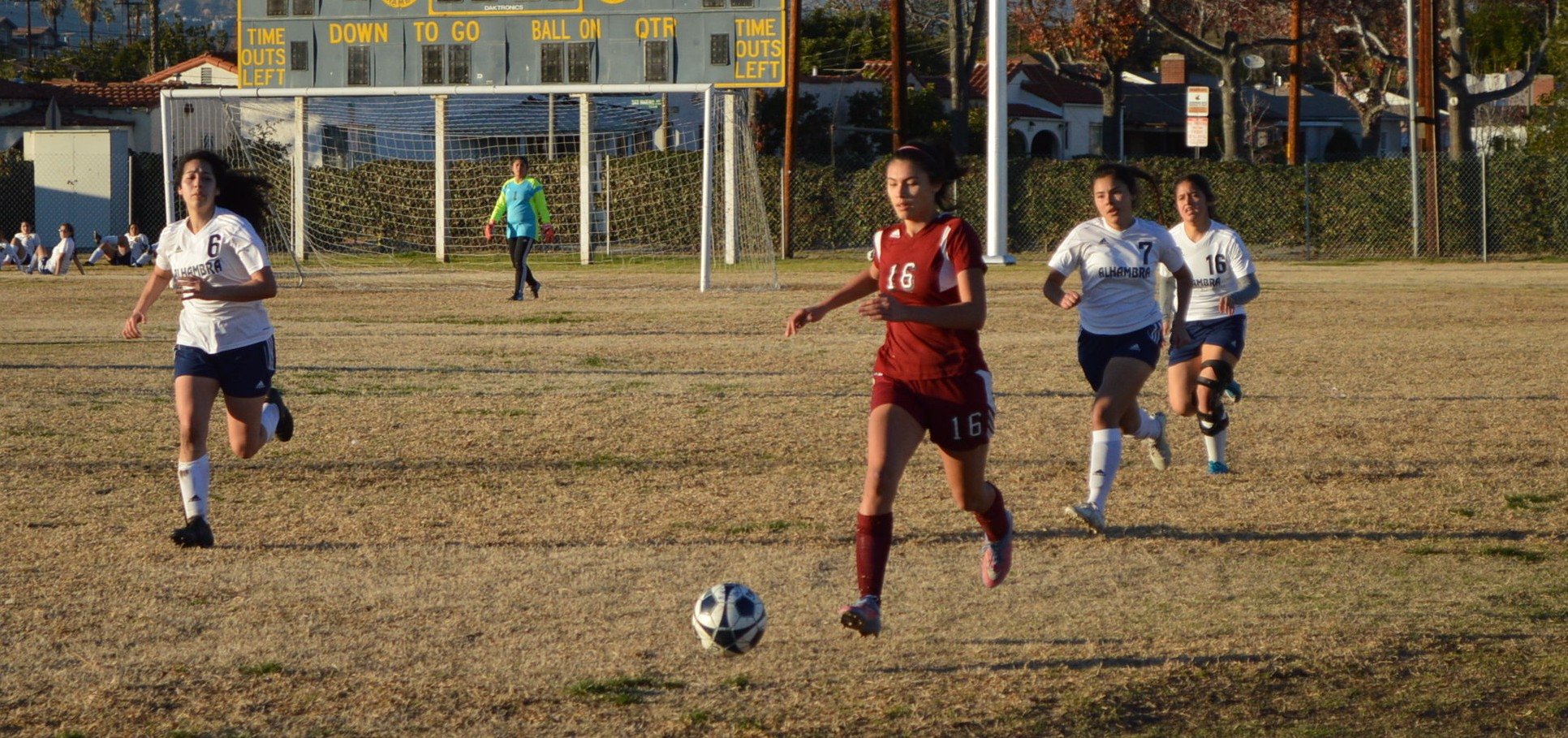 Freshman Noelle Frasher (16) dribbles the soccer ball down the field.