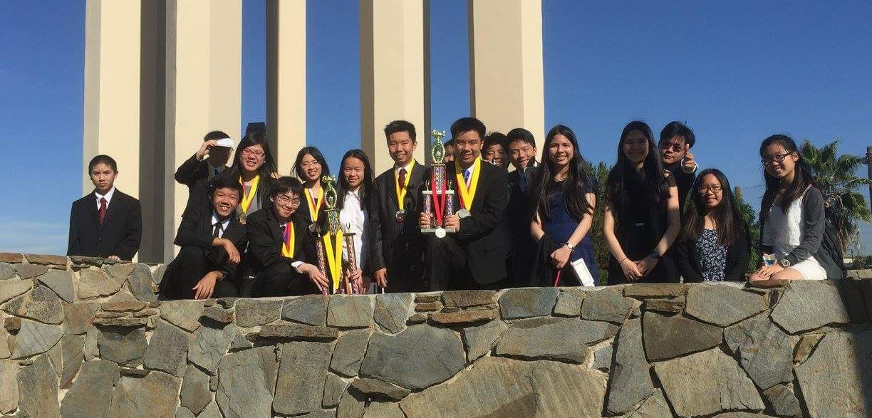 The Academic Decathlon (ACADEC) team with their competition trophies. COURTESY OF CHRISTINA TRAN.