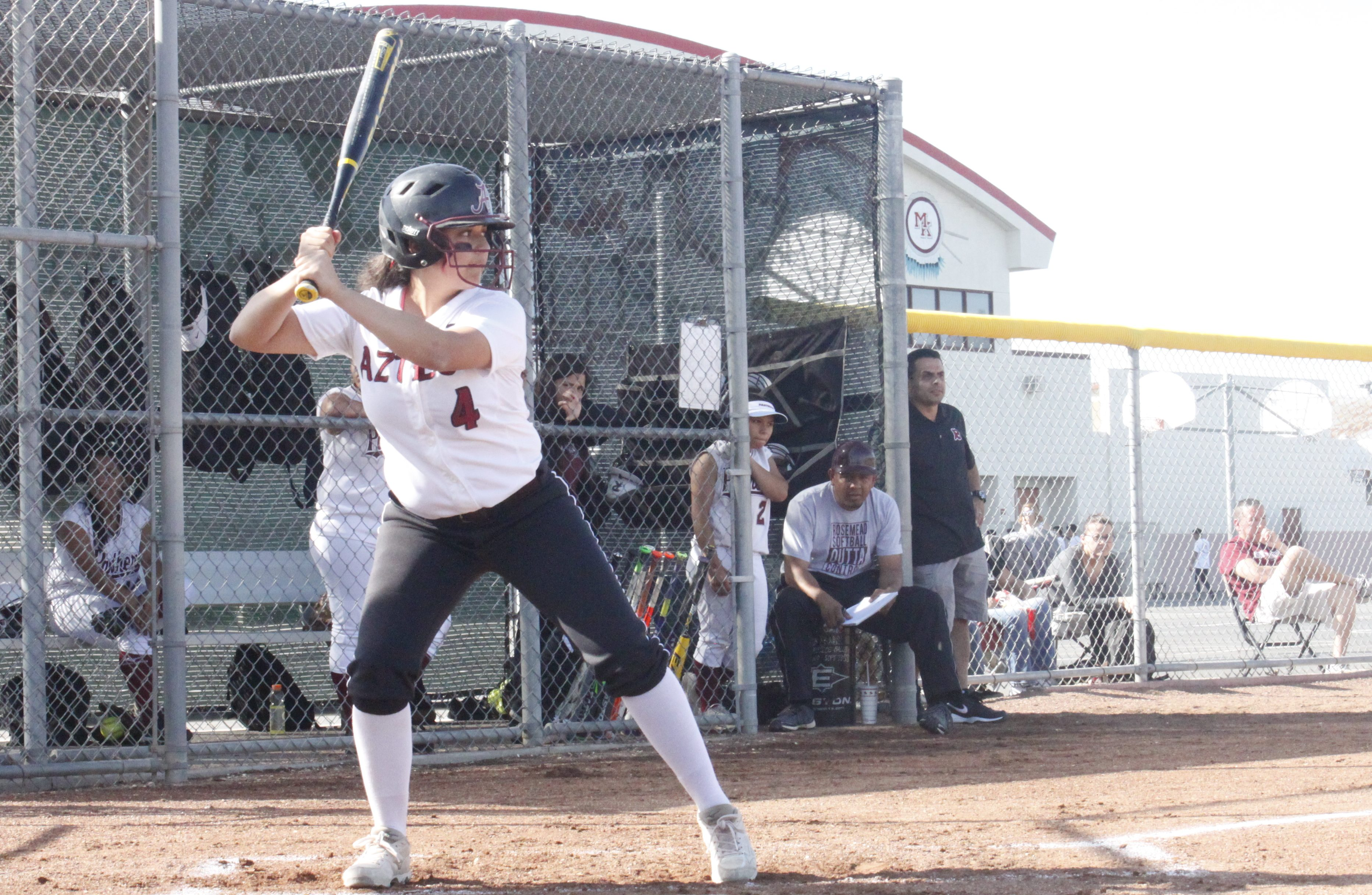 Sophomore Jacqueline Sandoval eyes the ball as she prepares to bat. THE AZTEC
