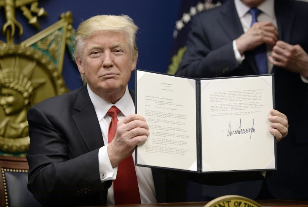 US President Donald Trump signs Executive Orders in the Hall of Heroes at the Department of Defense Friday, Jan. 27, 2017 in Arlington, Va. (Olivier Douliery/Abaca Press/TNS) 1196704
