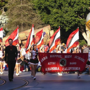 Band and Color Guard sync in parade competition at Disneyland